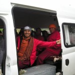 Monks in a minibus