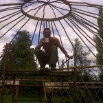 Man building Yurt